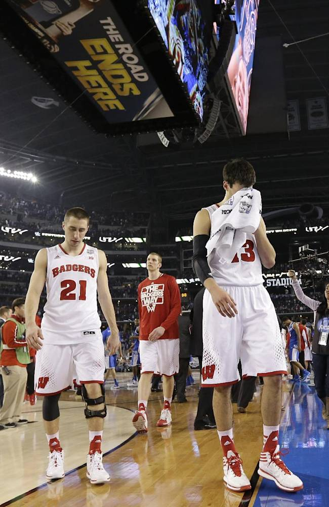 Wisconsin forward Duje Dukan, right, and guard Josh Gasser, left, walk off the court after an NCAA Final Four tournament college basketball semifinal game against Kentucky Saturday, April 5, 2014, in Arlington, Texas. Kentucky won 74-73