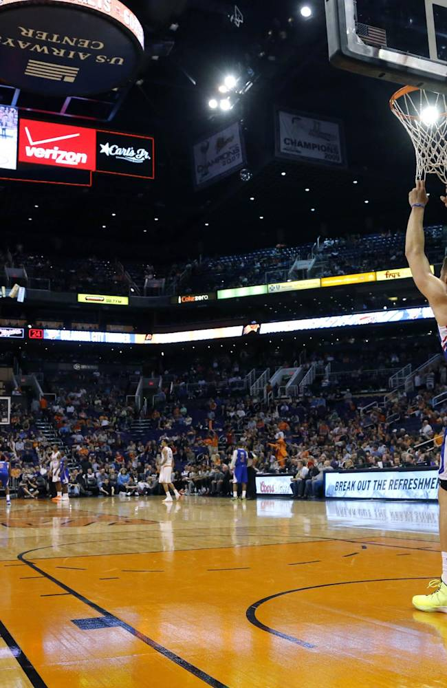 Los Angeles Clippers' Blake Griffin pulls on the nets during a foul shot by the Phoenix Suns during the second half of an NBA basketball game, Tuesday, March 4, 2014, in Phoenix