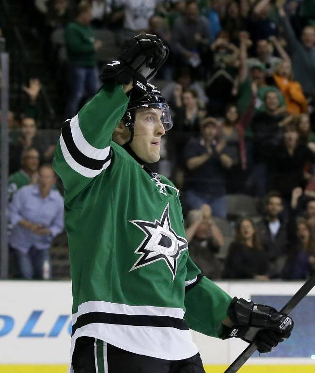 Dallas Stars' Ryan Garbutt, front, celebrates his goal against the Nashville Predators as Cody Eakin, left rear, watches in the first period of an NHL hockey game, Friday, March 28, 2014, in Dallas
