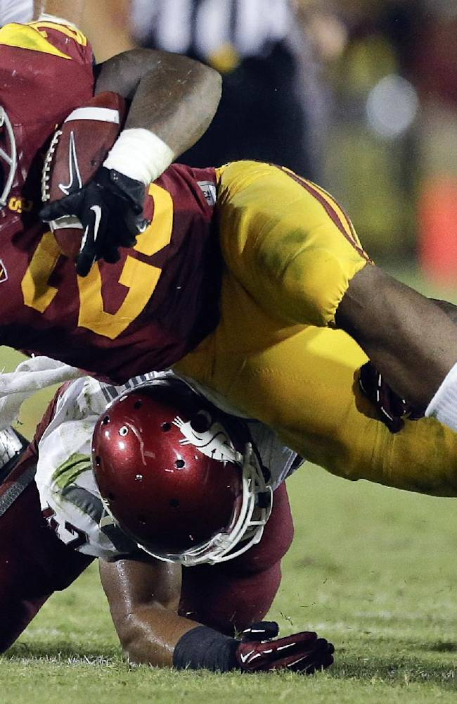 Down to 1 QB, USC hosts surging Boston College