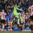 Sunderland goalkeeper Vito Mannone, center left, fights for the ball with Chelsea's Ramires during their English Premier League soccer match at the Stamford Bridge ground in London, Saturday April 19, 2014. Sunderland won the match 2-1
