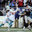 Miami Dolphins cornerback Cortland Finnegan, center, breaks up a pass intended for New England Patriots tight end Rob Gronkowski, right, in the first half of an NFL football game, Sunday, Dec. 14, 2014, in Foxborough, Mass The Associated Press