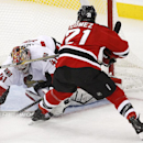 Ottawa Senators goalie Craig Anderson (41) blocks a shot by New Jersey Devils center Scott Gomez (21) during the third period of an NHL hockey game, Wednesday, Dec. 17, 2014, in Newark, N.J. The Senators won 2-0 The Associated Press