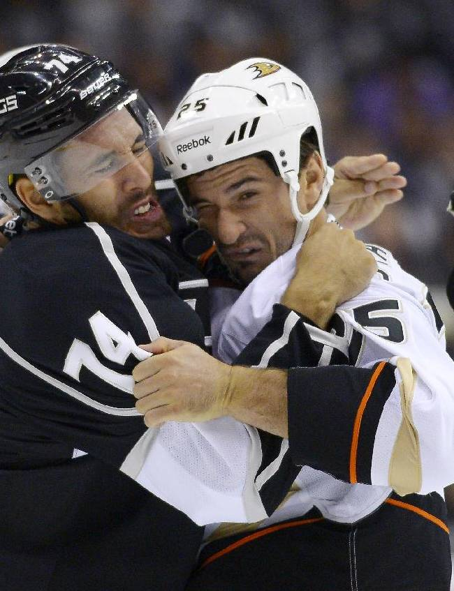 Los Angeles Kings center Dwight King, left, and Anaheim Ducks right wing Brad Staubitz fight during the first period of an NHL preseason hockey game, Tuesday, Sept. 24, 2013, in Los Angeles