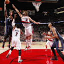PORTLAND, OR - NOVEMBER 17: Tyreke Evans #1 of the New Orleans Pelicans shoots over Wesley Matthews #2 and Robin Lopez #42 of the Portland Trail Blazers on November 17, 2014 at the Moda Center Arena in Portland, Oregon. (Photo by Cameron Browne/NBAE via Getty Images)