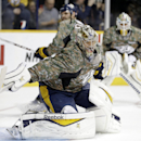 Nashville Predators goalie Pekka Rinne, of Finland, and his teammates wear camouflage jerseys as they warm up before an NHL hockey game against the Edmonton Oilers Tuesday, Nov. 11, 2014, in Nashville, Tenn The Associated Press