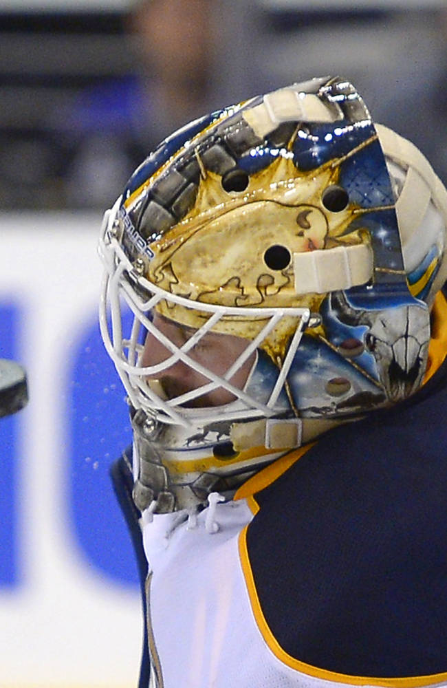 Buffalo Sabres goalie Jhonas Enroth, of Sweden, stops a shot during the second period of an NHL hockey game against the Los Angeles Kings, Thursday, Nov. 7, 2013, in Los Angeles