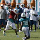 Miami Dolphins quarterback Matt Moore (8) passes during NFL football training camp in Davie, Fla., Sunday, July 27, 2014 The Associated Press