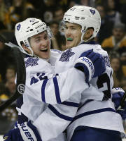 Toronto Maple Leafs left wing James van Riemsdyk, right, celebrates his goal against the Boston Bruins with teammate center Tyler Bozak (42) in the third period of an NHL hockey game in Boston, Tuesday, Jan. 14, 2014. The Maple Leafs won 4-3. (AP Photo/Elise Amendola)