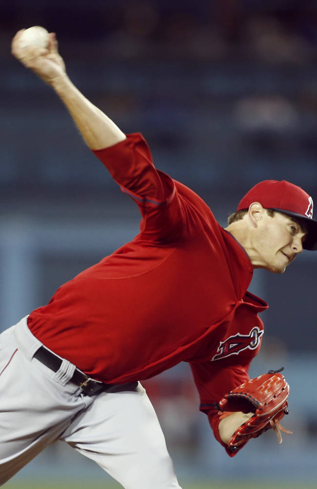 Los Angeles Angels starting pitcher Garrett Richards delivers against the Los Angeles Dodgers during the first inning of an exhibition baseball game in Los Angeles, Friday, March 28, 2014