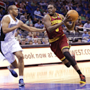 Cleveland Cavaliers' Luol Deng, right, drives around Orlando Magic's Arron Afflalo, left, during the first half of an NBA basketball game in Orlando, Fla., Wednesday, April 2, 2014 The Associated Press