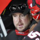 Kurt Busch talks to a crew member before practice for Sunday's NASCAR Coca-Cola 600 Sprint Cup series auto race at Charlotte Motor Speedway in Concord, N.C., Thursday, May 21, 2015. (AP Photo/Terry Renna)