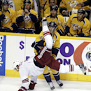 Arizona Coyotes defenseman David Schlemko flips as he collides with Nashville Predators center Craig Smith (15) in the second period of an NHL hockey game Tuesday, Oct. 21, 2014, in Nashville, Tenn The Associated Press