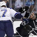 Los Angeles Kings defenseman Alec Martinez, right, skates into the stick of St. Louis Blues center Vladimir Sobotka during the first period of an NHL hockey game in Los Angeles, Monday, Dec. 2, 2013 The Associated Press