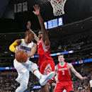 Denver Nuggets guard Randy Foye, left, drives the lane for a shot as Houston Rockets forward Terrence Jones, center, and center Omer Asik, of Turkey, cover in the third quarter of the Nuggets' 123-116 victory in an NBA basketball game in Denver on Wednesd