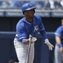 Kansas City Royals' Pedro Ciriaco heads to first on an RBI single during the third inning of an exhibition baseball game against the San Diego Padres on Wednesday, March 26, 2014, in Peoria, Ariz The Associated Press