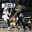 Sacramento Kings' DeMarcus Cousins (15) drives the baseline against Dallas Mavericks' Shawn Marion (0) in the first half of an NBA basketball game, Saturday, March 29, 2014, in Dallas The Associated Press