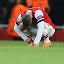 Arsenal's Jack Wilshere reacts after a Champions League, round of 16, first leg soccer match between Arsenal and Bayern Munich at the Emirates stadium in London, Wednesday, Feb. 19, 2014