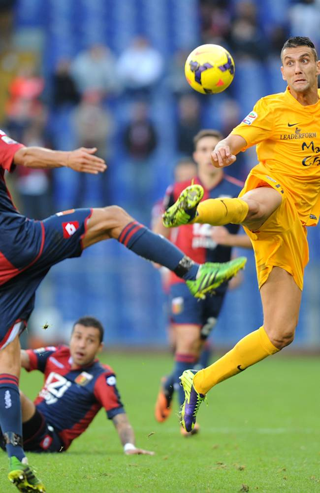 Genoa's Luca Antonini, left, vies for the ball with Verona's Bosko Jankovic during a Serie A soccer match between Genoa and Verona, in Genoa's Luigi Ferraris Stadium, Italy, Sunday, Nov. 10, 2013