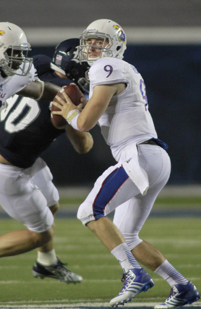 Kansas quarterback Jake Heaps looks to pass against Rice during the second half of an NCAA college football game Saturday, Sept. 14, 2013, in Houston