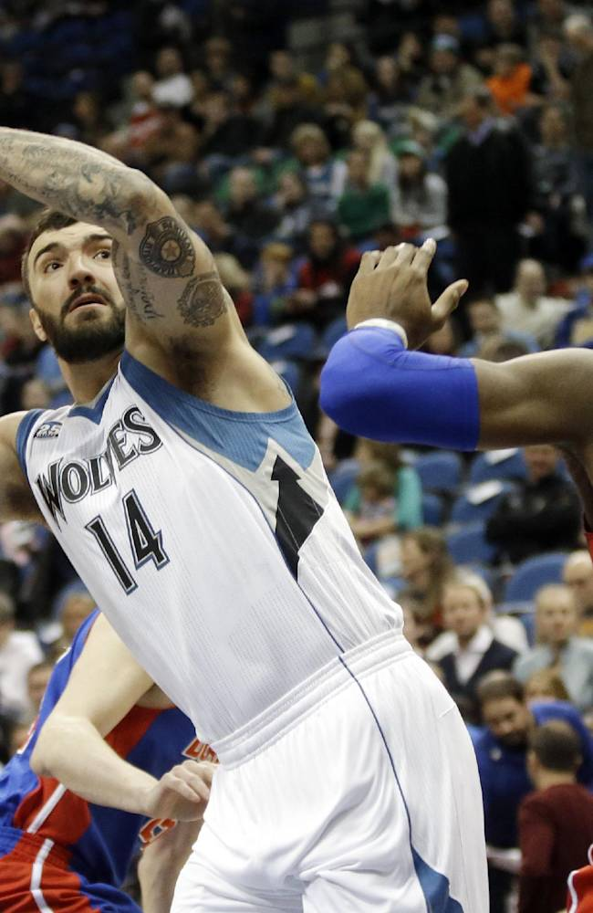 Minnesota Timberwolves' Nikola Pekovic, left, of Montenegro, eyes the basket as Detroit Pistons' Andre Drummond defends in the first quarter of an NBA basketball game, Friday, March 7, 2014, in Minneapolis