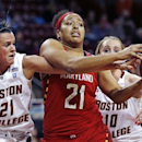 Boston College forward Kristen Doherty, left, pokes the ball away from Maryland forward Tianna Hawkins, center, during the first half of an NCAA college basketball game in Boston, Thursday, Feb. 21, 2013. (AP Photo/Charles Krupa)