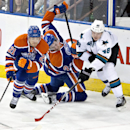 San Jose Sharks' Tomas Hertl (48) battles for the puck with Edmonton Oilers' Andrew Ference (21) and Jeff Petry (2) during second period NHL hockey action in Edmonton, Alberta, on Sunday, Dec. 7, 2014 The Associated Press