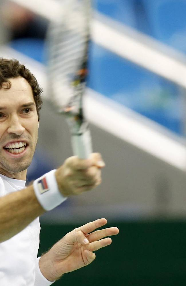 Kazakhstan's Mikhail Kukushkin returns a ball to Italy's Andreas Seppi during a semi final match at the Kremlin Cup tennis tournament in Moscow, Russia, Saturday, Oct. 19, 2013