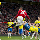 Manchester United's Robin van Persie, centre, beats Newcastle's Mathieu Debuchy, lower centre right, to score a disallowed goal during their English Premier League soccer match at the Old Trafford Stadium, Manchester, England, Saturday, Dec. 7, 2013
