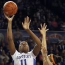 Kentucky's DeNesha Stallworth (11) shoots under pressure from Tennessee's Cierra Burdick during the first half of an NCAA college basketball game at Memorial Coliseum in Lexington, Ky., Sunday, March 3, 2013. (AP Photo/James Crisp)