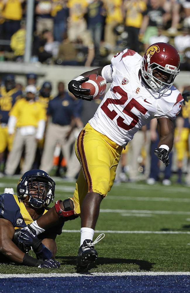 Southern California running back Silas Redd (25) runs past a California defender and scores a touchdown on a pass reception during the first quarter of an NCAA college football game Saturday, Nov. 9, 2013, in Berkeley, Calif. At right is USC wide receiver Darreus Rogers