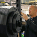 Shawn Griswold, Arizona State's head coach of sports performance for football, writes down notes at the football weight training room on Monday, July 21, 2014, in Tempe, Ariz The Associated Press