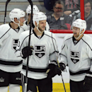 Los Angeles Kings' Trevor Lewis (22) celebrates his goal against the Ottawa Senators with teammates Kyle Clifford (13) Drew Doughty (8) and Tyler Toffoli (73) during the third period of an NHL hockey game, Thursday, Dec. 11, 2014 in Ottawa The Associated