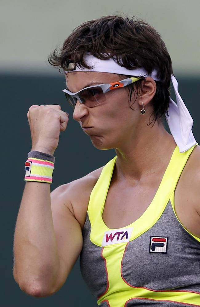 Yaroslava Shvedova, of Kazakhstan, celebrates after scoring a point against Serena Williams at the Sony Open tennis tournament in Key Biscayne, Fla., Thursday, March 20, 2014