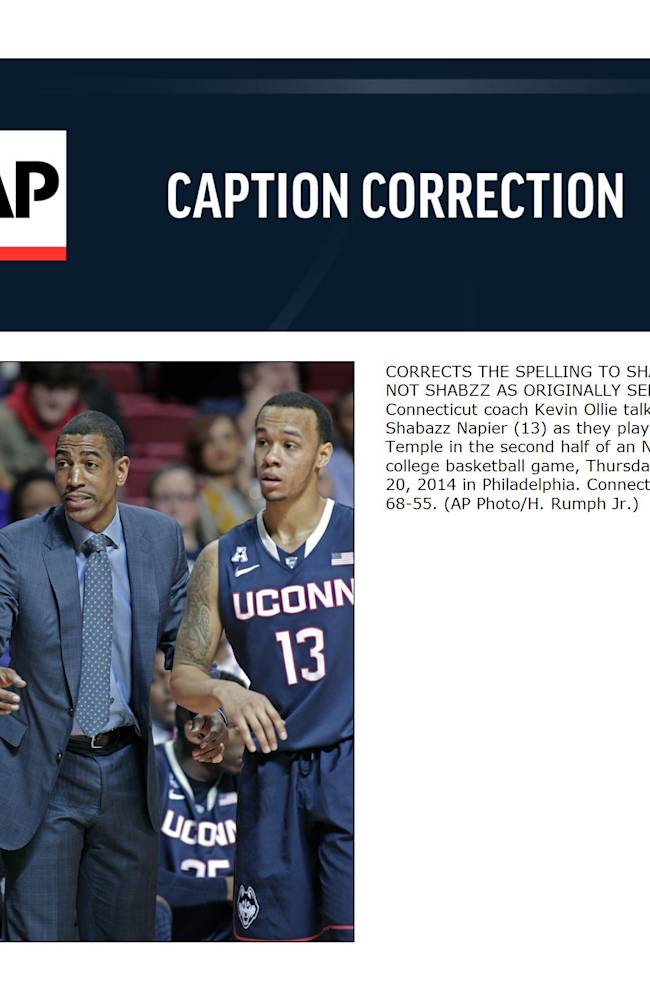 CORRECTS THE SPELLING TO SHABAZZ, NOT SHABZZ AS ORIGINALLY SENT - Connecticut coach Kevin Ollie talks to Shabazz Napier (13) as they play against Temple in the second half of an NCAA college basketball game, Thursday, Feb. 20, 2014 in Philadelphia. Connecticut won 68-55