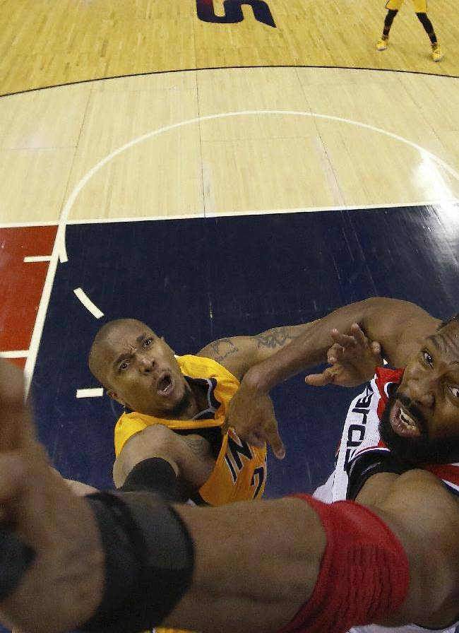 Washington Wizards forward Nene from Brazil, right, blocks Indiana Pacers forward David West, left, shot during the second half of Game 4 of an Eastern Conference semifinal NBA basketball playoff game in Washington, Sunday, May 11, 2014. The Pacers won 95-92