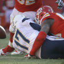 Kansas City Chiefs outside linebacker Justin Houston (50) sacks San Diego Chargers quarterback Philip Rivers (17), who fumbles for a turnover, during the second half of an NFL football game in Kansas City, Mo., Sunday, Dec. 28, 2014. (AP Photo/Charlie Riedel)