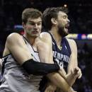 San Antonio Spurs' Tiago Splitter, left, of Brazil, and Memphis Grizzlies' Marc Gasol, right, of Spain, get tangled up as they chase a loose ball during the second half in Game 1 of a Western Conference Finals NBA basketball playoff series Sunday, May 19, 2013, in San Antonio. (AP Photo/Eric Gay)