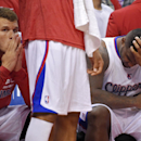 Los Angeles Clippers' Blake Griffin, left, looks on from the bench as Glen Davis rubs his head during the second half in Game 1 of an opening-round NBA basketball playoff series, Saturday, April 19, 2014, in Los Angeles. The Warriors won 109-105 The Assoc