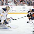 The Ducks' Corey Perry is stopped by Buffalo goaltender Michal Neuvirth during the Ducks' 4-1 victory over the Buffalo Sabres at Honda Center Wednesday night Oct. 22, 2014 The Associated Press