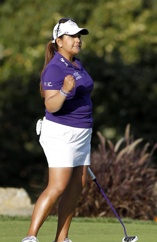 Lizette Salas pumps her fist after making a birdy putt on the 18th hole to come in second place during the final round of the LPGA Kia Classic golf tournament in Carlsbad, Calif., Sunday, March 30, 2014