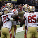 San Francisco 49ers running back Frank Gore (21) is congratulated by teammates after scoring on a touchdown carry in the first half of an NFL football game against the New Orleans Saints in New Orleans, Sunday, Nov. 9, 2014 The Associated Press