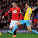 Manchester United's Wayne Rooney, left, and Crystal Palace's James McArthur battle for the ball during their English Premier League soccer match at Old Trafford, Manchester, England, Saturday, Nov. 8, 2014