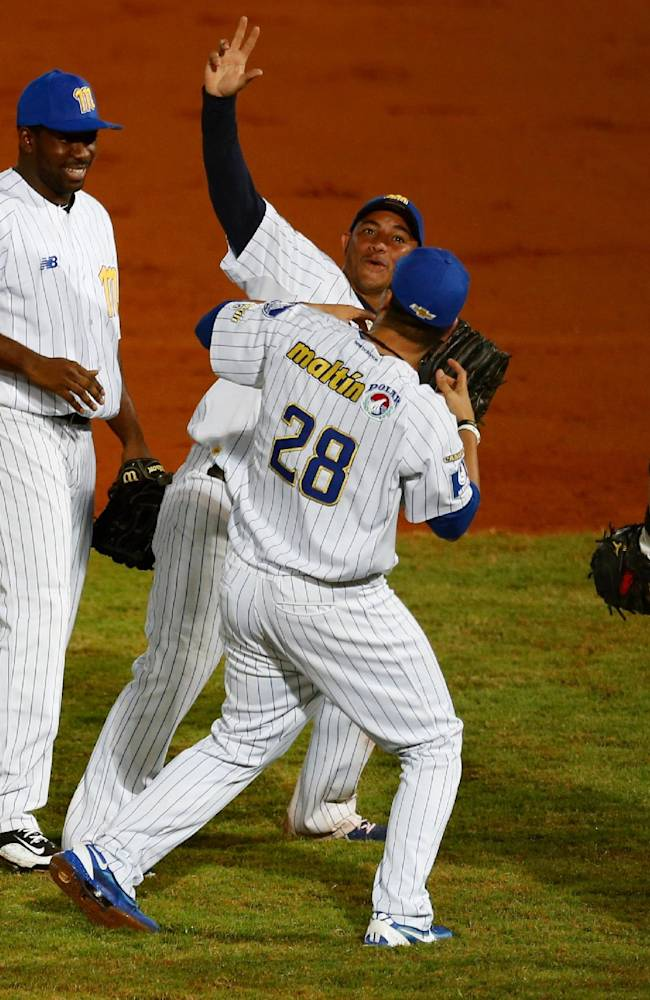 Venezuela players celebrate their 2-1 victory over the Dominican Republic at the end of their Caribbean Series baseball game in Porlamar, Venezuela, Wednesday, Feb. 5, 2014