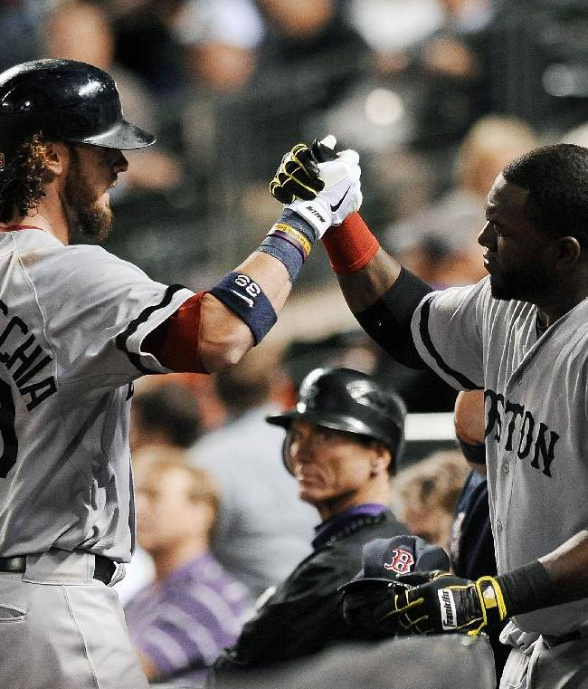 Boston Red Sox's David Ortiz, right, congratulates Jarrod Saltalamacchia after Saltalamacchia hit a two-run home run in the ninth inning of a baseball game against the Colorado Rockies on Tuesday, Sept. 24, 2013 in Denver. The Rockies won 8-3