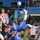 Chelsea's Fernando Torres, centre, takes a shot during the English Premier League soccer match against Sunderland at the Stamford Bridge ground in London, Saturday, April 19, 2014. Sunderland won the match 2-1