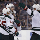 Minnesota Wild left wing Jason Zucker, second from left, celebrates his go-ahead goal with teammates Mathew Dumba (55), Mikko Koivu (9), of Finland, and Jason Zucker, behind, in the third period of an NHL hockey game against the Boston Bruins in Boston, T