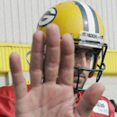 Green Bay Packers' Aaron Rodgers tries to block the lens as he arrives for NFL football training camp Monday, July 28, 2014, in Green Bay, Wis The Associated Press