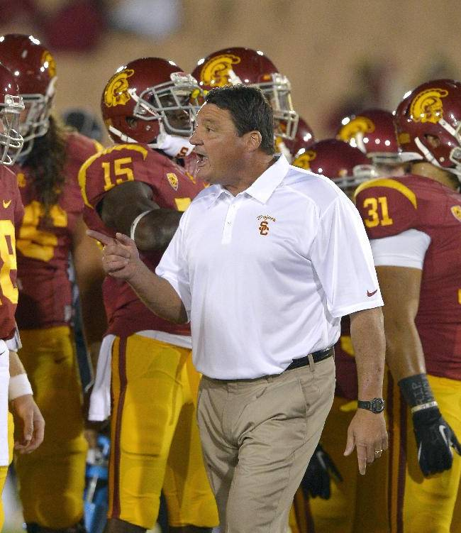 Southern California interim coach Ed Orgeron talks to his team prior to an NCAA college football game against Arizona, Thursday, Oct. 10, 2013, in Los Angeles