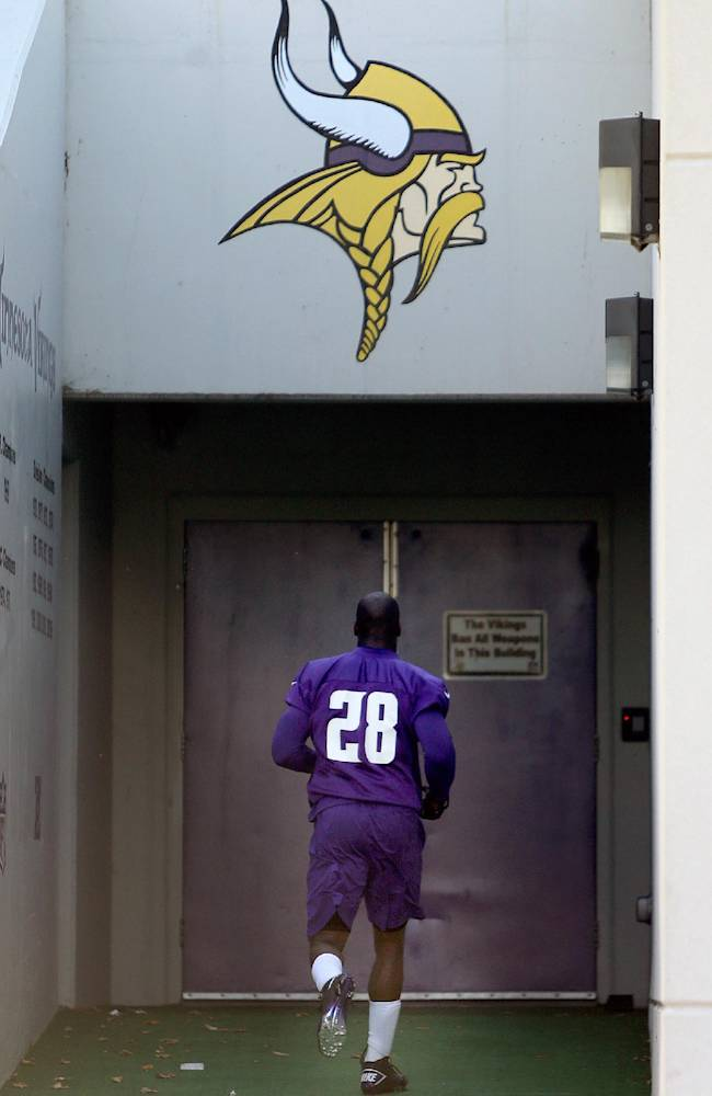 Minnesota Vikings' Adrian Peterson makes his way off an NFL football practice field at Winter Park in Eden Prairie, Minn., Friday, Oct. 11, 2013. Peterson said he is certain he will play Sunday despite a serious personal matter that caused him to miss practice earlier this week